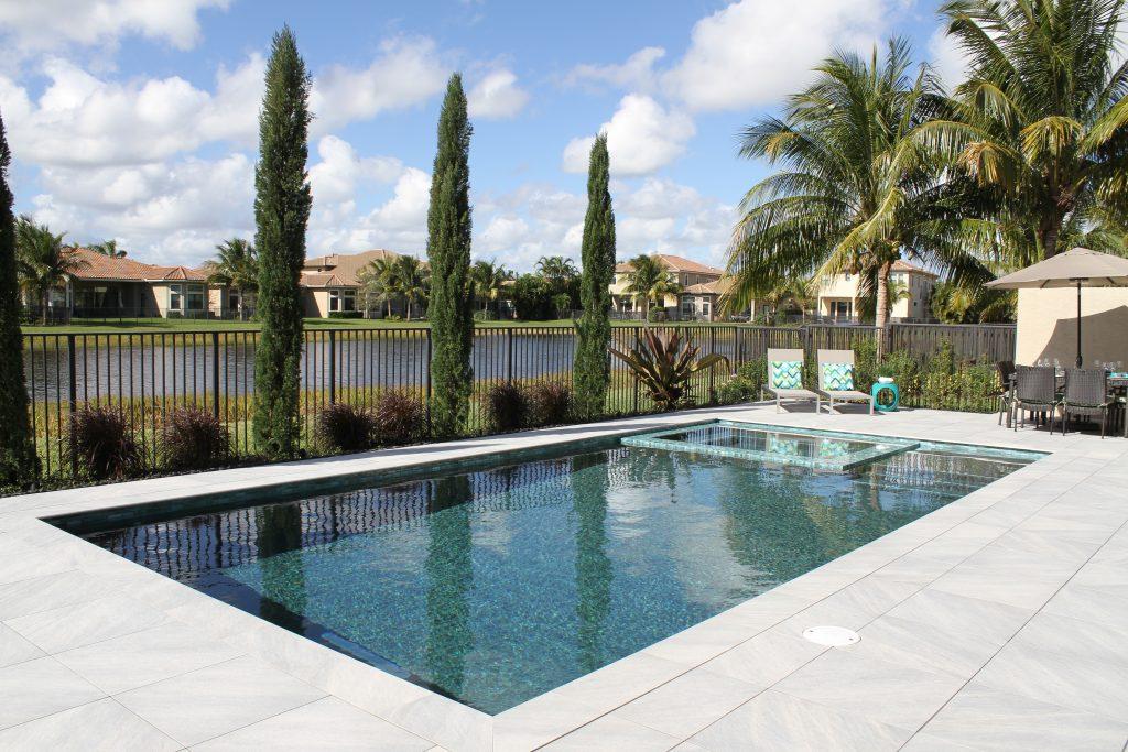 Porcelain Tile For Swimming Pool Decks : Porcelain tile decks treasure pools